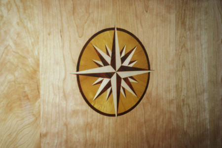 Compass rose inlay in Cocobolo, Maple and Orange Osage.