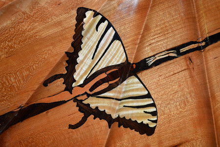 """The underside of this piece echoes Nakashima's butterfly keyway style, holding the cherry crotch in check. Just as my craftsmanship has 'metamorphosed' since the '70s, so too have these solid 2"""" hand carved 'Butterflies'. This natural progression of my form still retains its original function."""