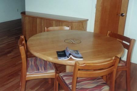 Matching teak game table.