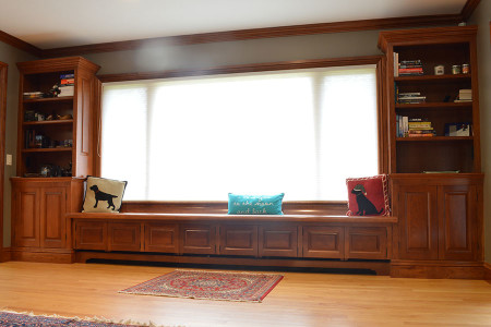 Cabinetry with 12' Settee frames picturesque mountain views. Integrated and modified for base board heating.
