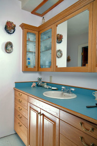 Bathroom Vanity, illuminated with antique glass. Overhead is an additional diffused 2 strip fluorescent light, for good makeup lighting.