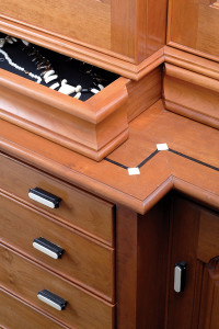 Drawers discreetly disappear into the casework trim. Custom Ebony and Ivory knobs. Inlays, to accent or mask imperfections of an otherwise beautiful piece.