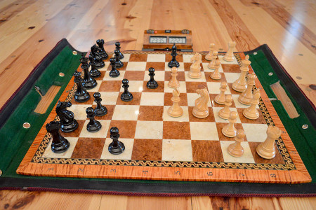 """""""Win a Prize"""" - Name this position and win coffee, shortbread and a 3 rnd G/25 d3 unr. – U2882 afternoon entertainment. It's the juxtaposition of a chessboards elegance, to the games savagery, which I do enjoy, and try to bring out when appropriate in all my works."""