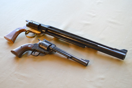 """Dirty Harry's .44 and Alex's supersized fully functional """"magnum"""" rubber band shooter."""